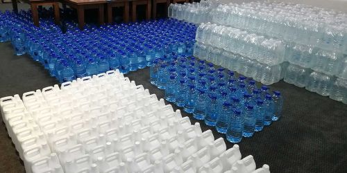 Bottled water and sanitisers ready to be handed out in communities, healthcare facilities and schools