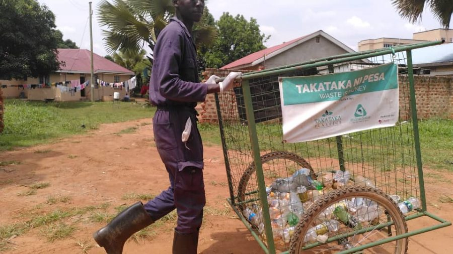 Man carrying cart to transport plastic waste
