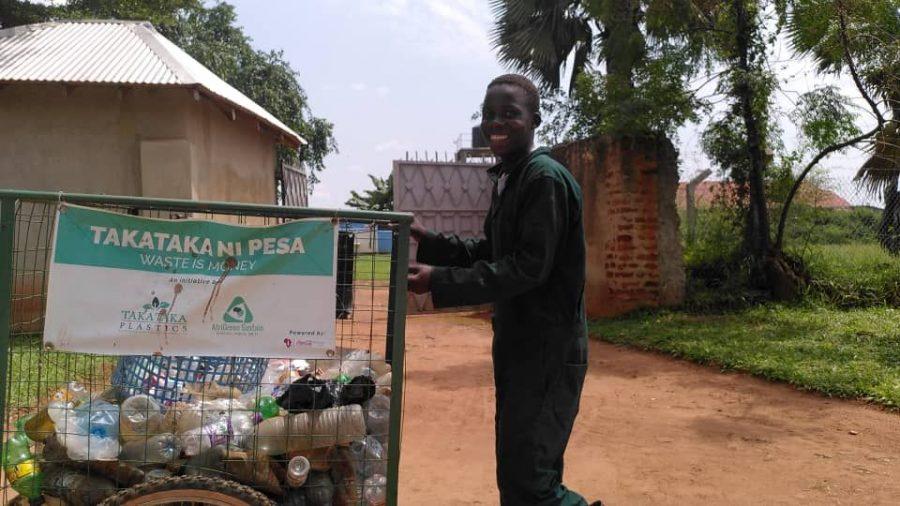 man transporting plastic bottles